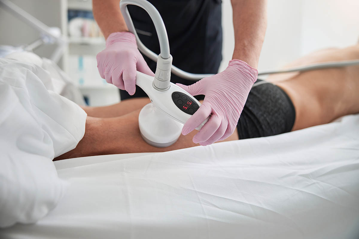 patient undergoing ultrasonic liposuction on thighs