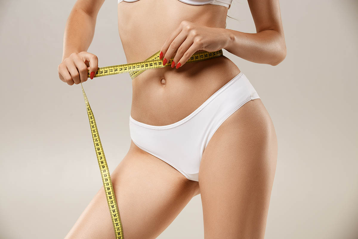 woman with flat tummy after tummy tuck